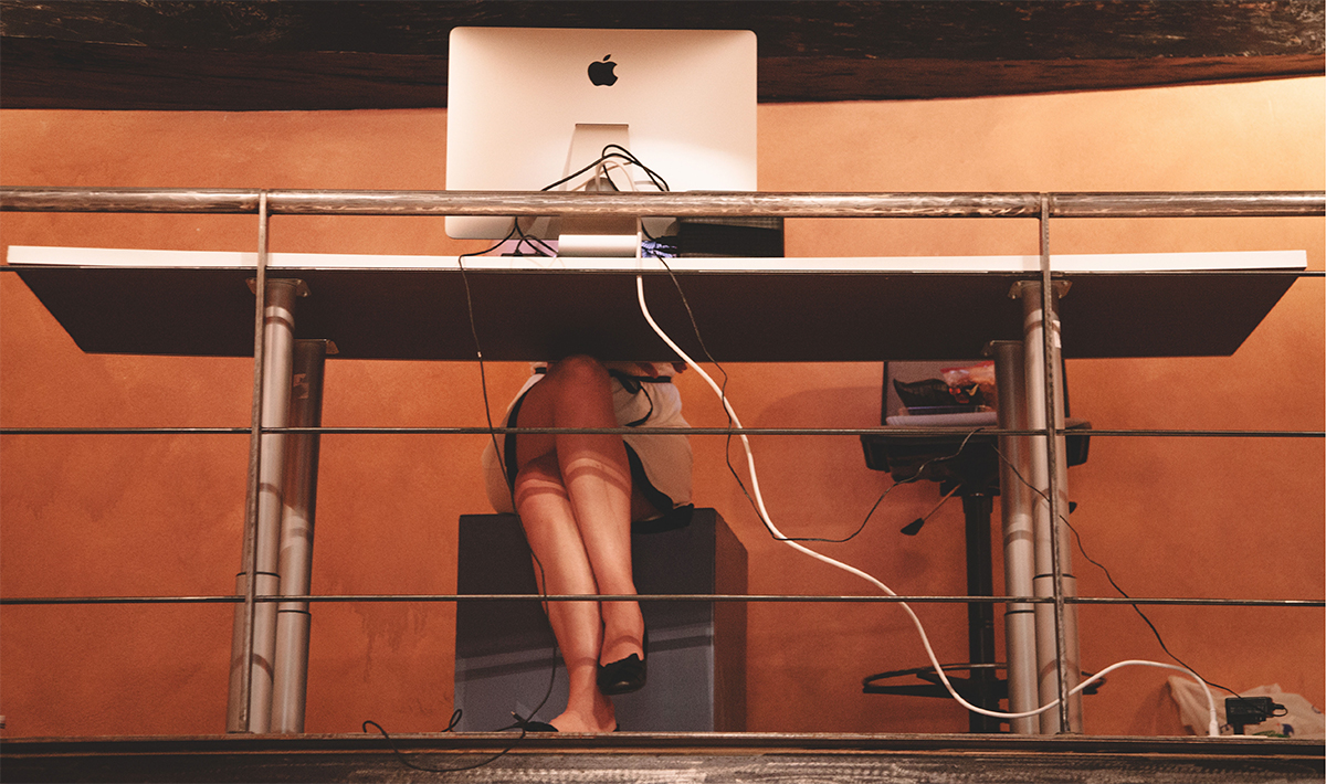 Woman legs under office desk in studio